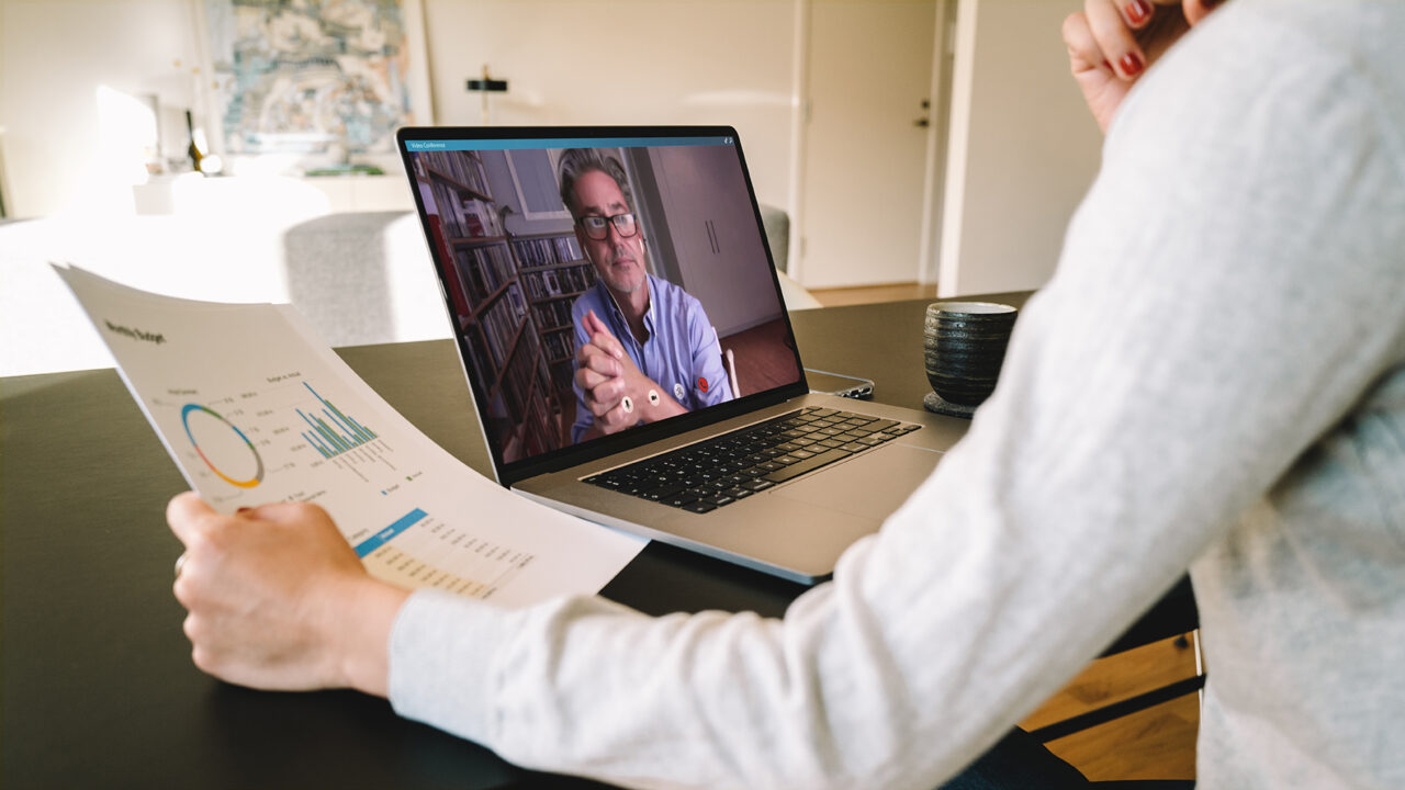Woman making video call to business partner