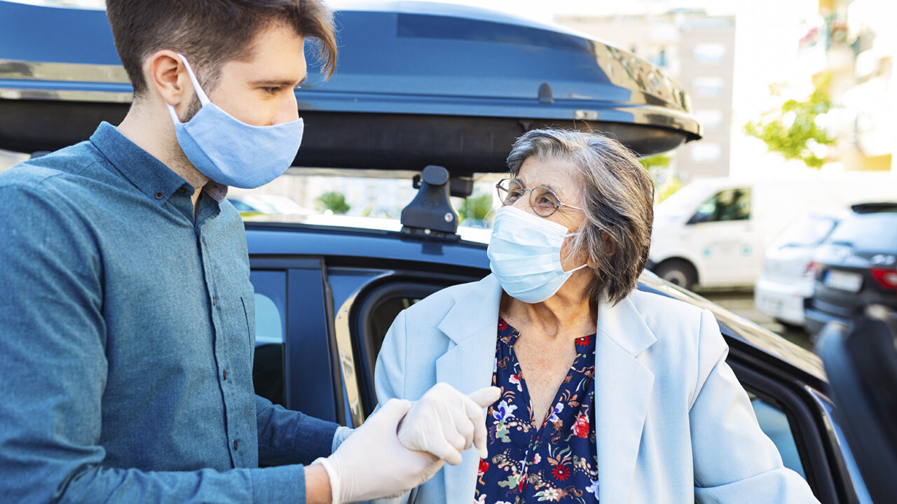 Senior women in a car with caregiver